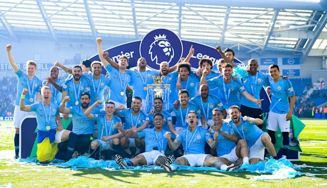 Manchester City celebrate with the Premier League (Photo by Michael Regan/Getty Images)