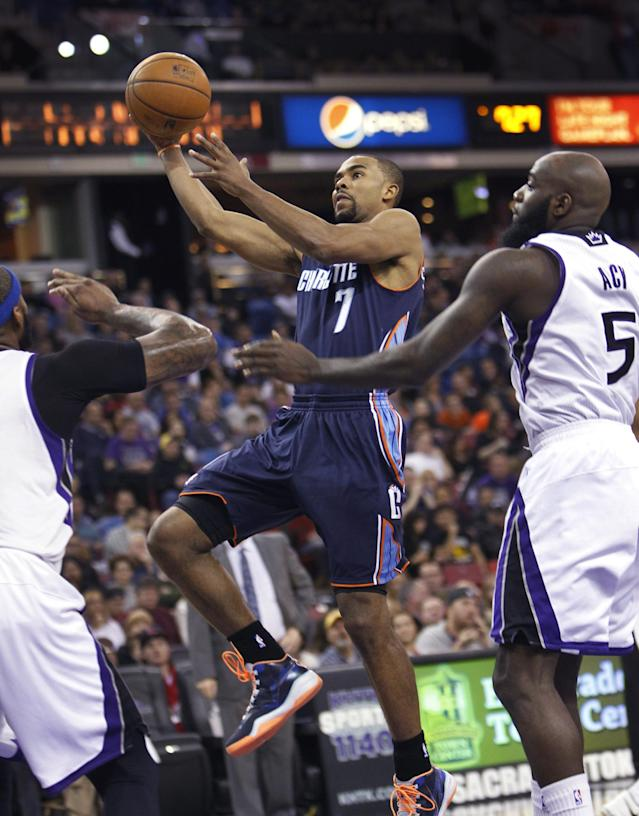 Charlotte Bobcats guard Ramon Sessions (7) drives to the basket against Sacramento Kings defender Quincy Acy (5) during the first half of an NBA basketball game in Sacramento, Calif., on Saturday, Jan. 4, 2014.(AP Photo/Steve Yeater)
