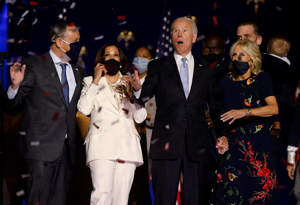 Democratic 2020 U.S. presidential nominee Joe Biden and his wife Jill, and Democratic 2020 U.S. vice presidential nominee Kamala Harris and her husband Doug, react to the confetti at their election rally, after the news media announced that Biden has won the 2020 U.S. presidential election over President Donald Trump, in Wilmington, Delaware, U.S., November 7, 2020. REUTERS/Jim Bourg     TPX IMAGES OF THE DAY