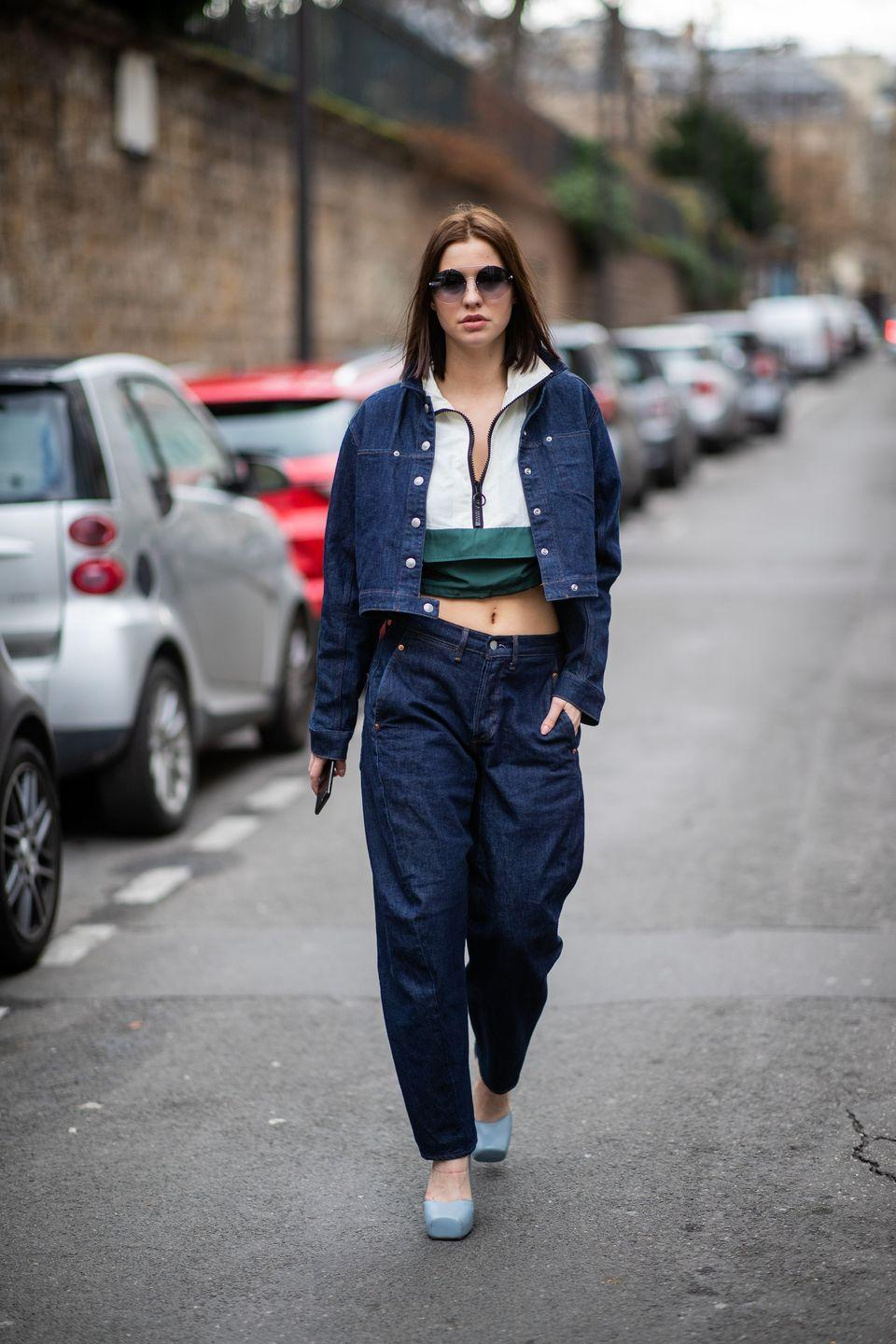 <p>This is the Sporty Spice take on styling the denim trend: an unexpected quarter-zip peeking out from underneath a jean jacket. Pair it with a baggy pair of jeans to nail the cool-girl aesthetic.</p>