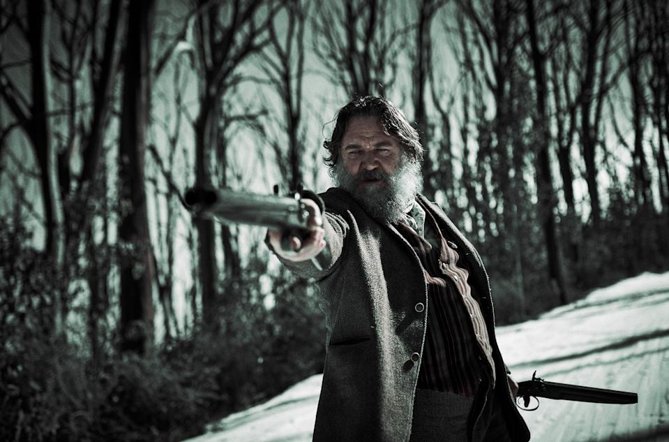 Russell Crowe wields a firearm as Harry Power in a still from <i>True History of the Kelly Gang</i>. (Picturehouse Entertainment)