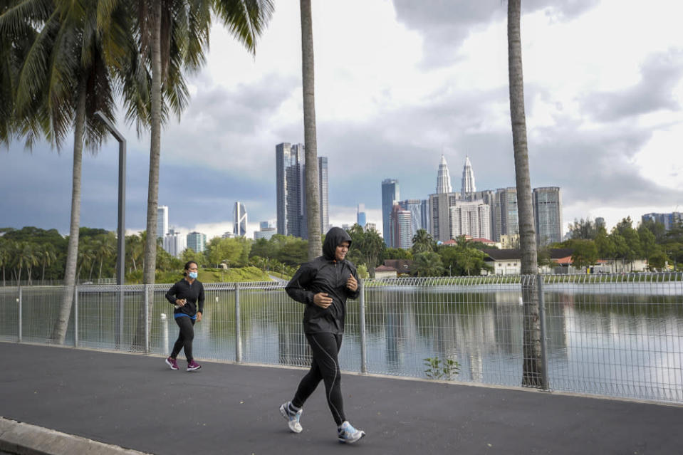 People are pictured jogging at the Titiwangsa lake park in Kuala Lumpur May 4, 2020. — Picture by Shafwan Zaidon