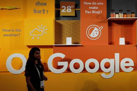 A woman walks past the logo of Google during an event in New Delhi, India, August 28, 2018. REUTERS/Adnan Abidi/Files
