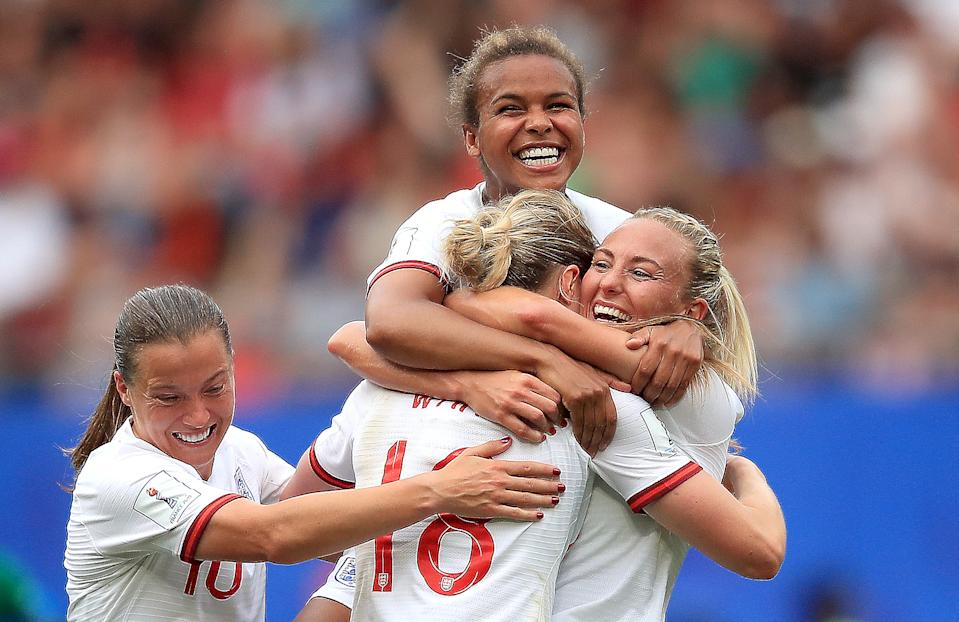 Ellen White of England celebrates with teammates after scoring her team's second goal during the 2019 FIFA Women's World Cup France Round Of 16 match between England and Cameroon at Stade du Hainaut on June 23, 2019 in Valenciennes, France. (Photo by Marc Atkins/Getty Images)