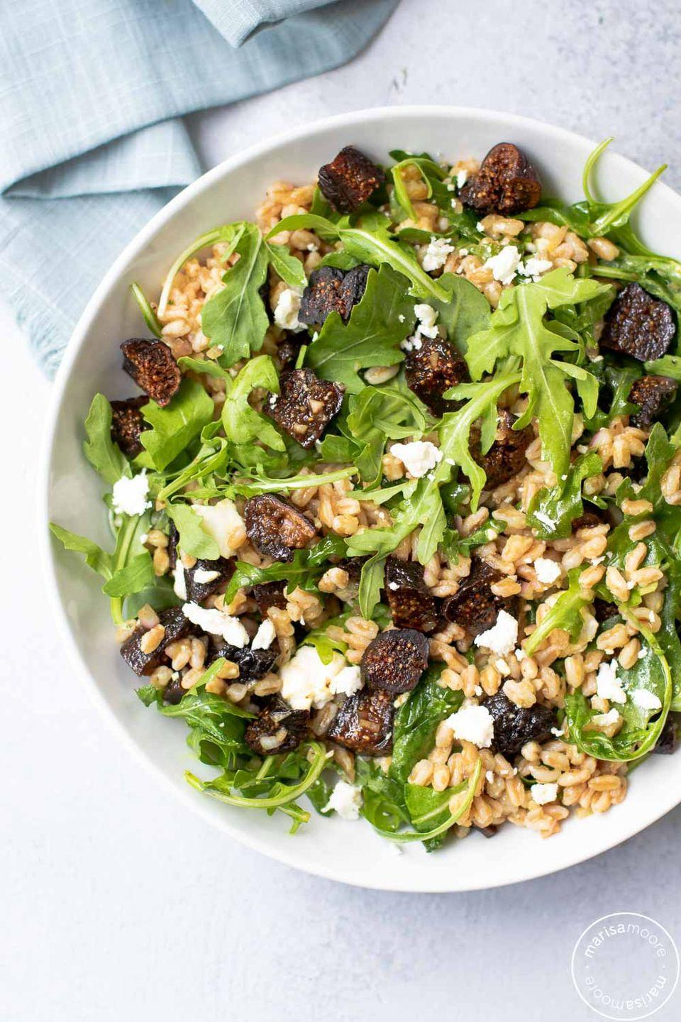 "<p>Sweet dried figs, hearty farro, tart goat cheese and bitter arugula combine to make a delicious and filling holiday salad.</p><p><strong>Get the recipe at <a href=""https://marisamoore.com/fig-farro-salad/"" rel=""nofollow noopener"" target=""_blank"" data-ylk=""slk:Marisa Moore"" class=""link rapid-noclick-resp"">Marisa Moore</a>.</strong> </p>"