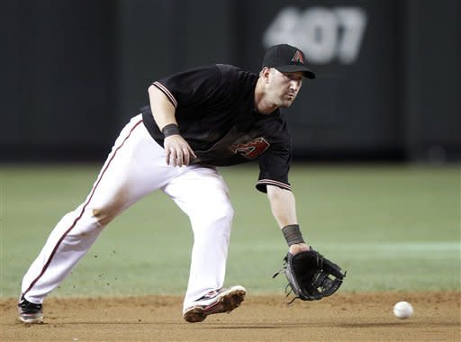 Arizona Diamondbacks shortstop Willie Bloomquist fields a ground ball hit for an out by San Francisco Giants' Matt Cain in the second inning of a baseball game Saturday, May 12, 2012, in Phoenix.(AP Photo/Paul Connors)