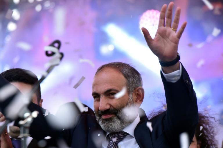 Armenian opposition leader Nikol Pashinyan waves to supporters after being elected prime minister last month