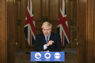 Britain's Prime Minister Boris Johnson speaks, during a coronavirus media briefing in Downing Street, London, Tuesday, Oct. 20, 2020. British Prime Minister Boris Johnson says he is imposing the highest level of coronavirus restrictions on the Greater Manchester region, after days-long negotiations between his government and local leaders who reject the measures broke down with no deal reached. (Leon Neal/Pool Photo via AP)