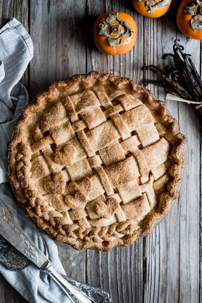 "<p>Truly an underrepresented fruit, persimmons are a rich fall treat. This fruity pie is warm, sweet, and perfectly spiced. Enjoy the comforting flavors of vanilla and pear with every bite you take.</p> <p><strong>Get the recipe</strong>: <a href=""https://www.snixykitchen.com/vanilla-bean-pear-persimmon-pie/"" class=""link rapid-noclick-resp"" rel=""nofollow noopener"" target=""_blank"" data-ylk=""slk:vanilla-bean pear persimmon pie"">vanilla-bean pear persimmon pie</a></p>"