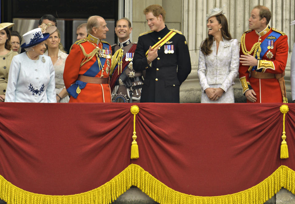 (Front L-R) Britain's Queen Elizabeth, Prince Philip, Prince Harry, Prince William, the Duke of Cambridge and his wife, Catherine, the Duchess of Cambridge share a light moment as they stand on the balcony of Buckingham Palace in the annual Trooping of the Colour ceremony to celebrate the Queen's official birthday in central London, June 14, 2014. REUTERS/Toby Melville (BRITAIN - Tags: SOCIETY ANNIVERSARY ROYALS)