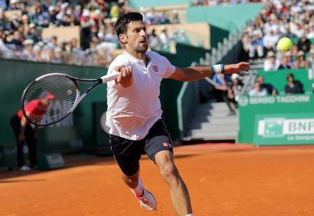 Tennis - Monte Carlo Masters - Monaco, 21/04/2017. Novak Djokovic of Serbia plays a shot to David Goffin of Belgium. REUTERS/Eric Gaillard