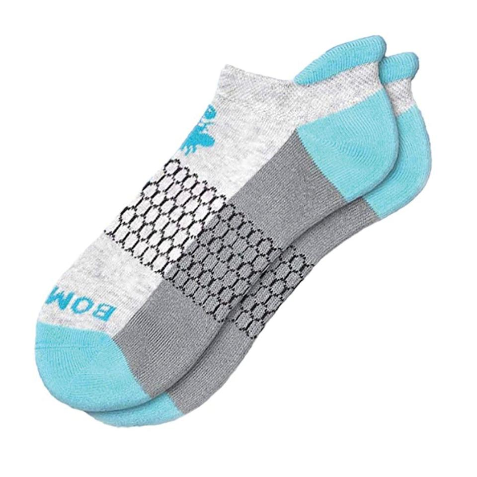 """<p><strong>BOMBAS</strong></p><p>amazon.com</p><p><strong>$20.98</strong></p><p><a href=""""https://www.amazon.com/dp/B07HH73ZRZ?tag=syn-yahoo-20&ascsubtag=%5Bartid%7C2142.g.36448024%5Bsrc%7Cyahoo-us"""" rel=""""nofollow noopener"""" target=""""_blank"""" data-ylk=""""slk:Shop Now"""" class=""""link rapid-noclick-resp"""">Shop Now</a></p><p>Bombas' Honeycomb Support System cradles the middle part of your foot in what feels like a giant cottony hug giving you top-tier arch support.</p>"""