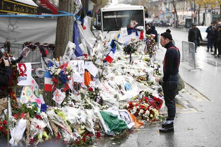 Jesse Hughes, member of Eagles of Death Metal band, mourns in front of the Bataclan concert hall to pay tribute to the shooting victims in Paris, France, December 8, 2015. REUTERS/Charles Platiau