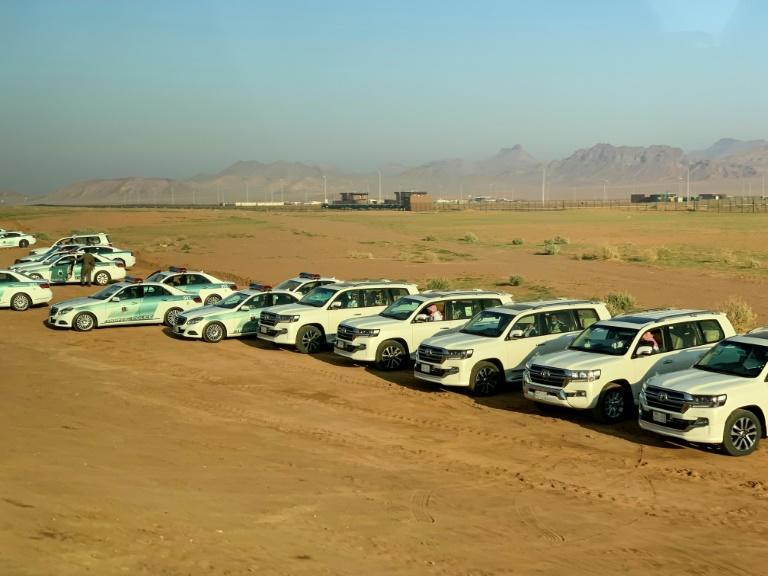 Saudi police vehicles wait at Al-Ula airport to escort visiting heads of state, including the Qatari emir, to the summit venue