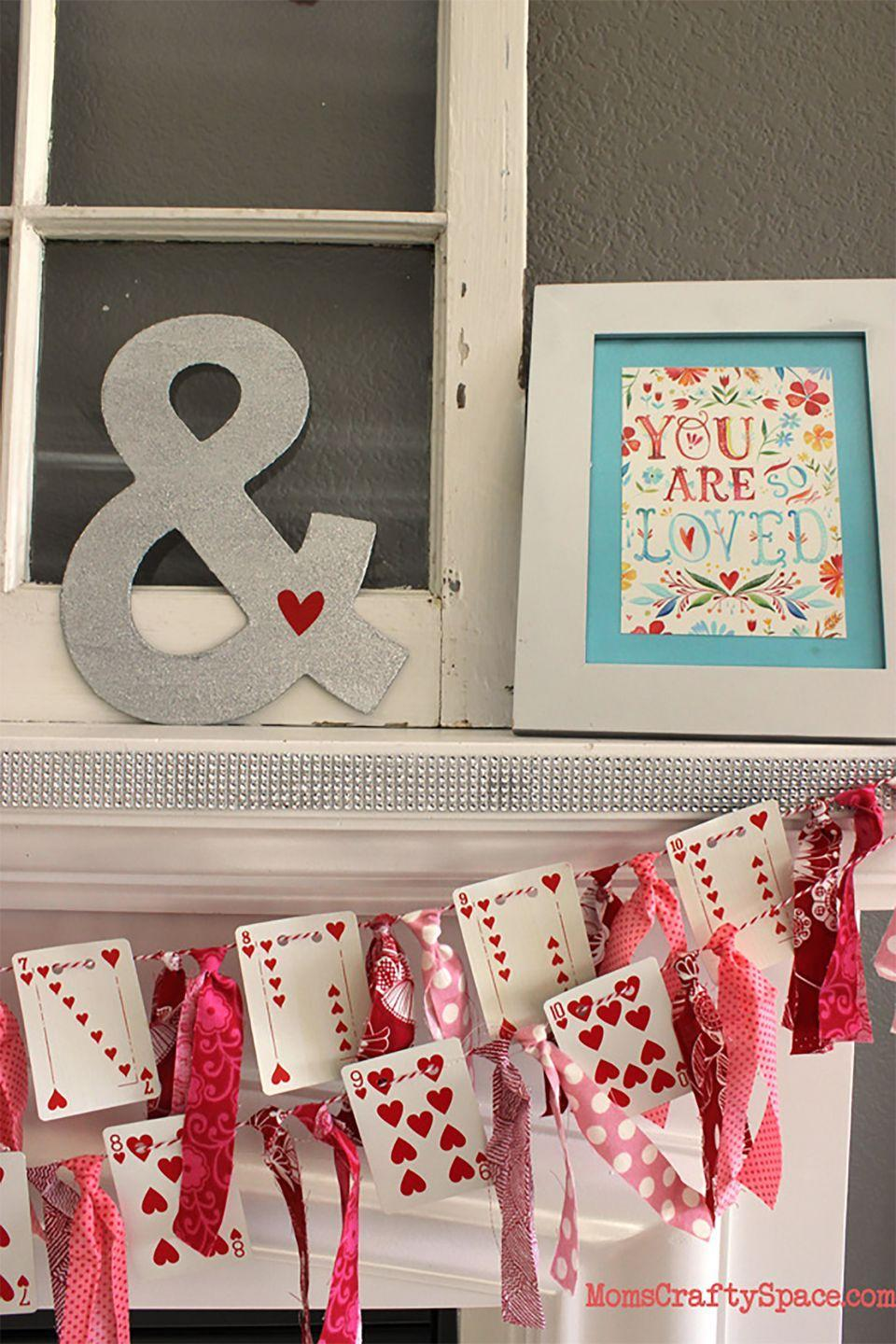 """<p>A deck of cards becomes a lovely decoration for the Queen of Hearts.</p><p><strong>Get the tutorial at <a href=""""https://www.happinessishomemade.net/valentines-day-heart-cards-garland/"""" rel=""""nofollow noopener"""" target=""""_blank"""" data-ylk=""""slk:Happiness Is Homemade"""" class=""""link rapid-noclick-resp"""">Happiness Is Homemade</a>.</strong></p><p><strong><a class=""""link rapid-noclick-resp"""" href=""""https://www.amazon.com/Best-Sellers-Toys-Games-Standard-Playing-Card-Decks/zgbs/toys-and-games/166244011?tag=syn-yahoo-20&ascsubtag=%5Bartid%7C10050.g.2971%5Bsrc%7Cyahoo-us"""" rel=""""nofollow noopener"""" target=""""_blank"""" data-ylk=""""slk:SHOP PLAYING CARDS"""">SHOP PLAYING CARDS</a><br></strong></p>"""