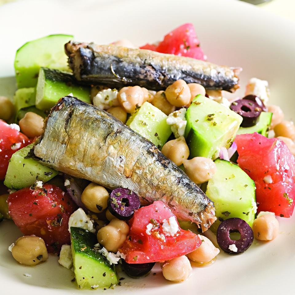 <p>The fresh, tangy elements of a Greek salad--tomato, cucumber, feta, olives and lemony vinaigrette--pair well with rich-tasting sardines. Look for sardines with skin and bones (which are edible) as they have more than four times the amount of calcium as skinless, boneless sardines. If you're lucky enough to have fresh sardines available in your supermarket, try them in place of the canned sardines. Lightly dredge them in salt-and-pepper-seasoned flour and sauté them in a little olive oil.</p>