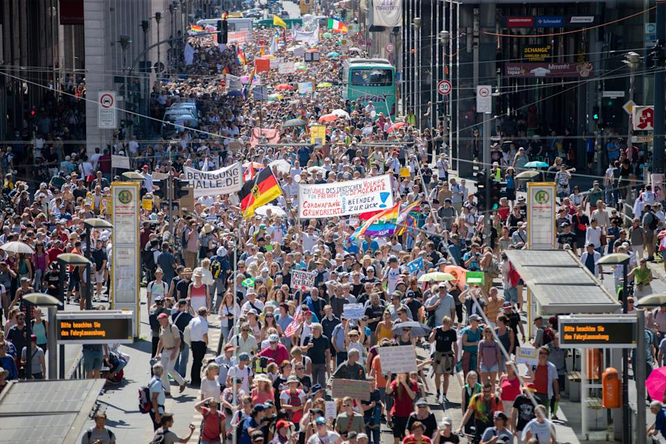"""Thousands march along the 'Friedrichstrasse' during the demonstration against corona measures in Berlin, Germany, Saturday, Aug. 1, 2020. The initiative """"Querdenken 711"""" has called for this. The motto of the demonstration is """"The end of the pandemic - Freedom Day."""""""