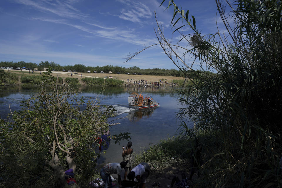 Members of Mexico's Migration Institute patrol the area of the Rio Grande that separates the cities of Del Rio, Texas, and Ciudad Acuña, Mexico, Wednesday, Sept. 22, 2021. (AP Photo/Fernando Llano)