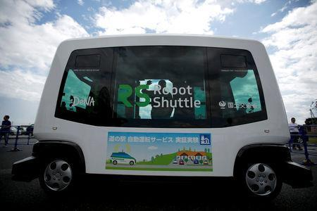 Robot Shuttle, a driver-less, self driving bus, developed by Japan's internet commerce and mobile games provider DeNA Co., is parked during an experimental trial with a self-driving bus in a community in Nishikata town, Tochigi Prefecture, Japan September 8, 2017. Picture taken September 8, 2017. REUTERS/Issei Kato