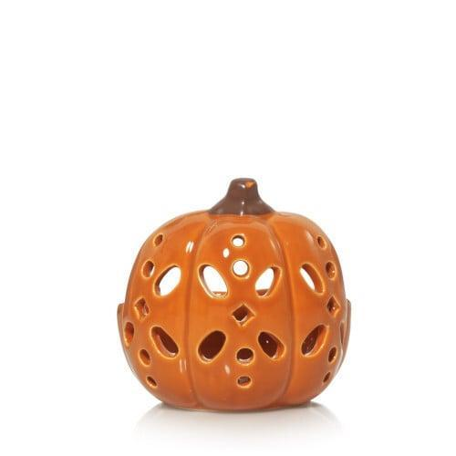 <p>This <span>Pierced Pumpkin Tea Light Candle Holder</span> ($8) would look nice in any room of the house.</p>