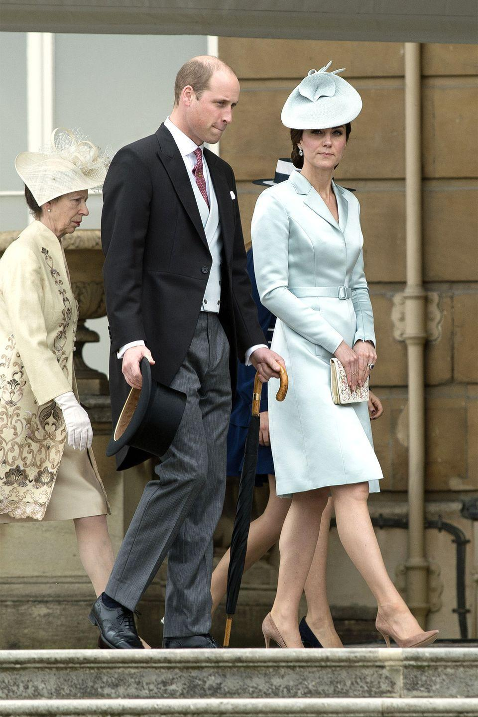 <p>The Duchess wears a pale blue Christopher Kane silk satin coatdress and matching John Lock and Co hat, embroidered clutch and suede nude pumps at a garden party at Buckingham Palace.</p>