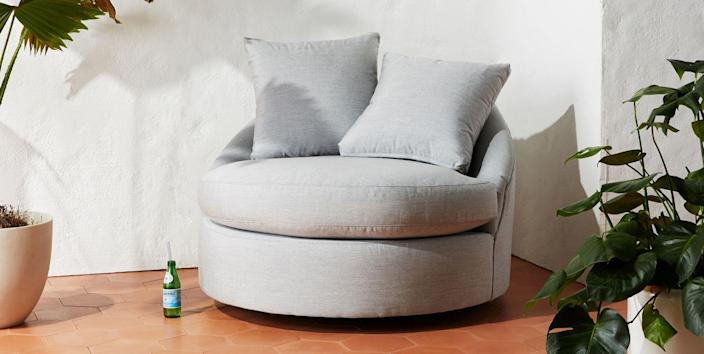 """Don't you want to spin around on this plush swivel chair? What's even greater is that you get to customize the color and fabric of your chair. $1498, Anthropologie. <a href=""""https://www.anthropologie.com/shop/barwick-indooroutdoor-swivel-chair?category=outdoor-furniture&color=&type=STANDARD"""" rel=""""nofollow noopener"""" target=""""_blank"""" data-ylk=""""slk:Get it now!"""" class=""""link rapid-noclick-resp"""">Get it now!</a>"""