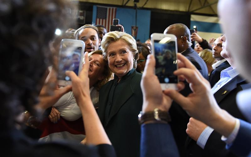 Tech industry titans from Apple, Twitter and Wikipedia, among others, have thrown their support behind Hillary Clinton in an open letter (AFP Photo/Robyn Beck)