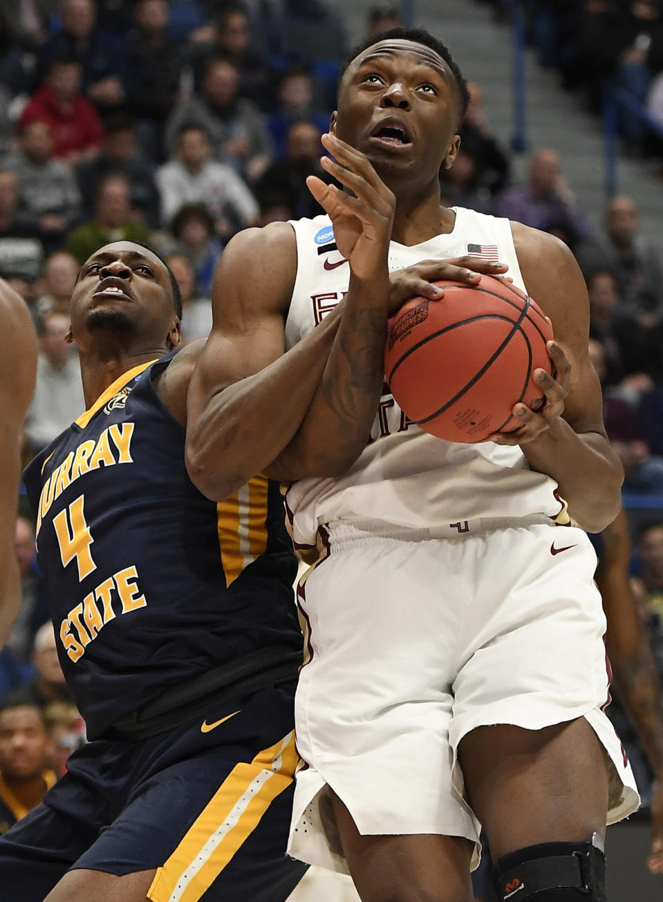 <p>Florida State's Mfiondu Kabengele (25) tangles with Murray State's Brion Sanchious (4) as he pulls down a rebound during the first half of a second round men's college basketball game in the NCAA tournament, Saturday, March 23, 2019, in Hartford, Conn. (AP Photo/Jessica Hill) </p>