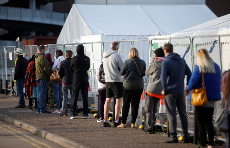 People queue outside a test centre in Southend-on-sea