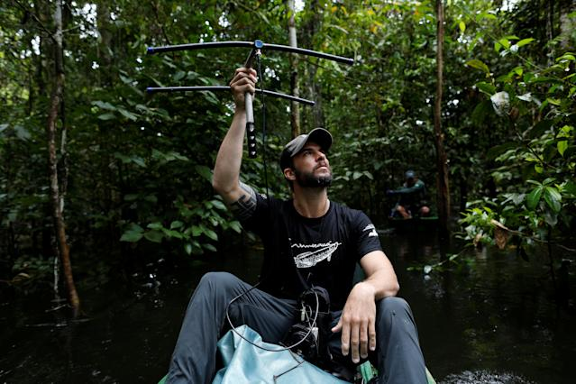 <p>Lead researcher Emiliano Esterci Ramalho from the Mamiraua Institute uses a radio device to locate jaguars at the Mamiraua Sustainable Development Reserve in Uarini, Amazonas state, Brazil, May 30, 2017. (Photo: Bruno Kelly/Reuters) </p>
