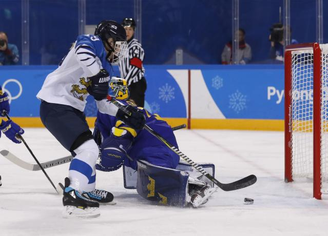 Ice Hockey - Pyeongchang 2018 Winter Olympics - Women's Quarterfinal Match - Finland v Sweden - Kwandong Hockey Centre, Gangneung, South Korea - February 17, 2018 - Petra Nieminen of Finland scores against goalkeeper Sara Grahn of Sweden. REUTERS/Kim Kyung-Hoon