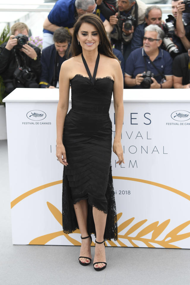 <p>At a photo call for <em>Everybody Knows,</em> the Spanish star decided on a lacy black gown with a halterneck, which she paired with strappy heels. (Photo: Getty) </p>