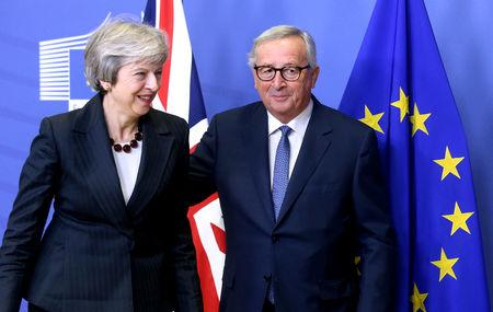 FILE PHOTO: British Prime Minister Theresa May and European Commission President Jean-Claude Juncker leave to discuss draft agreements on Brexit, at the EC headquarters in Brussels, Belgium November 21, 2018.  REUTERS/Francois Walschaerts/File Photo