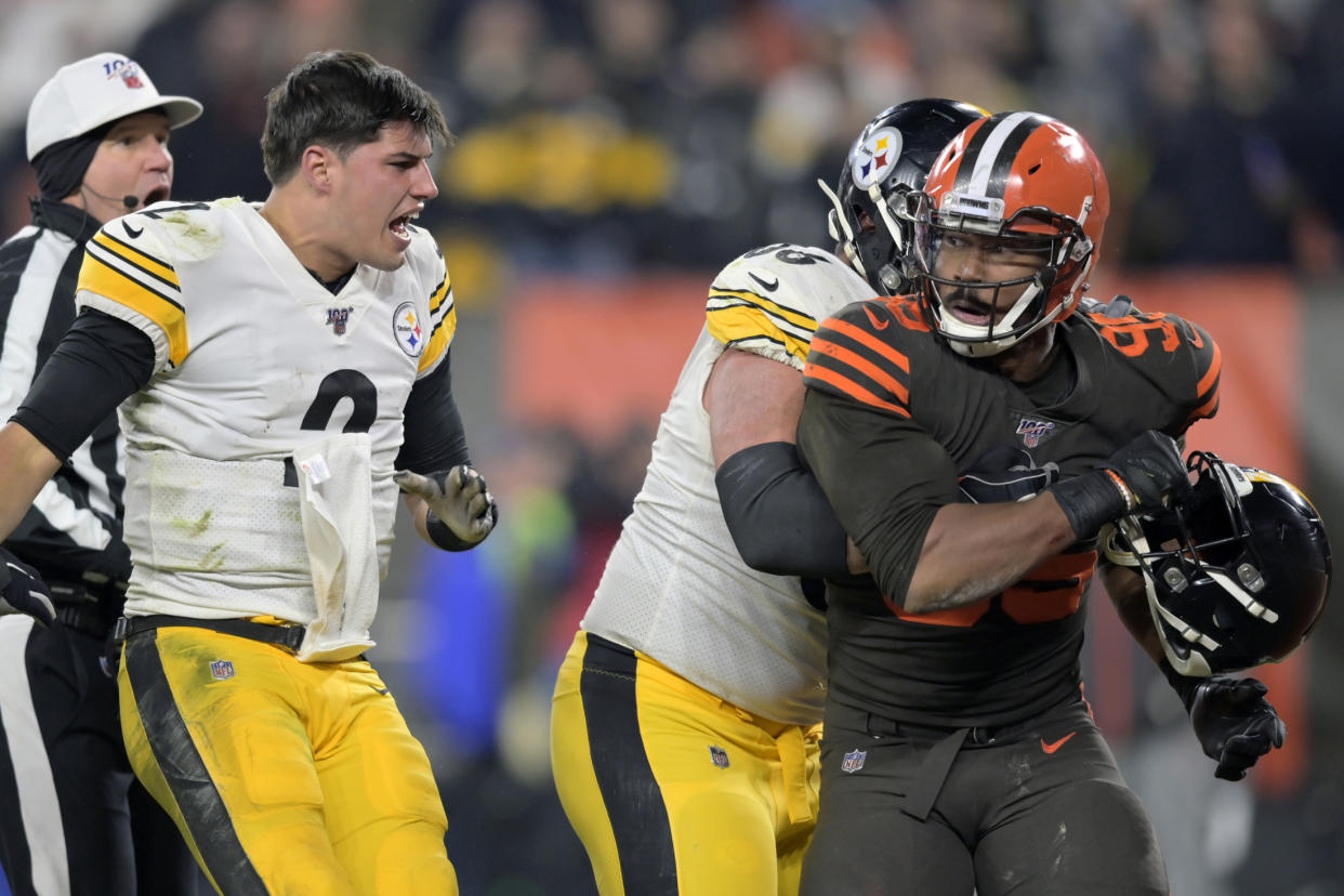 Cleveland Browns defensive end Myles Garrett (95) reacts after swinging a helmet at Pittsburgh Steelers quarterback Mason Rudolph. (AP Photo/David Richard)