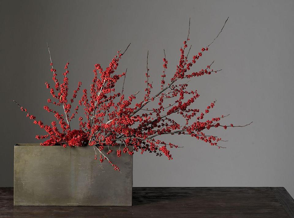 "<p>Go the modern route this year by styling just a few berry branches in an elegant box vase.</p><p><em>Via <a href=""http://www.decorationinc.com"" rel=""nofollow noopener"" target=""_blank"" data-ylk=""slk:Decoration Inc."" class=""link rapid-noclick-resp"">Decoration Inc.</a></em></p>"