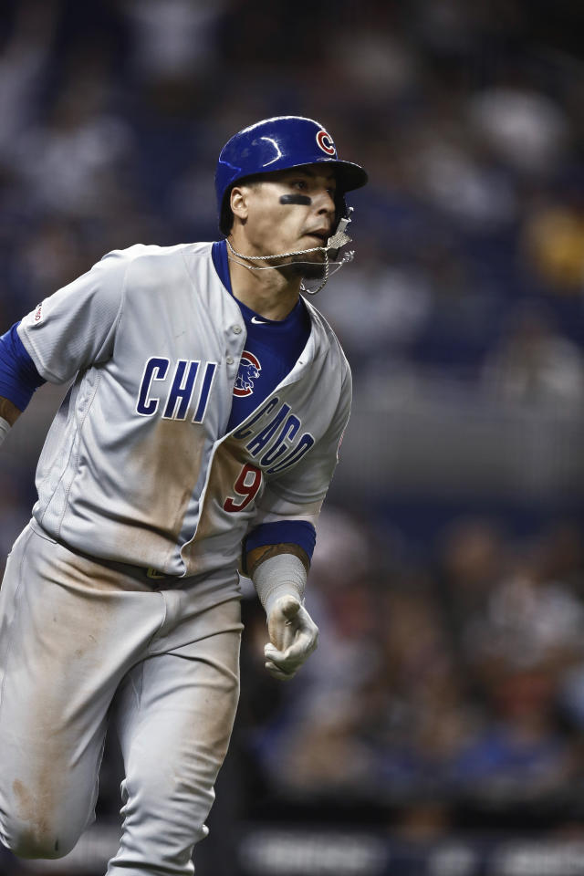 Chicago Cubs' Javier Baez runs to first base after he hitting a solo home run during the eighth inning of the team's baseball game against the Miami Marlins on Wednesday, April 17, 2019, in Miami. (AP Photo/Brynn Anderson)