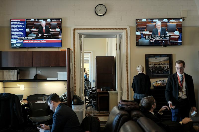 Reporters watch the senate impeachment trial begin in the press gallery off the senate floor at the Capitol in Washington, D.C. on Jan. 21, 2020. | Gabriella Demczuk for TIME