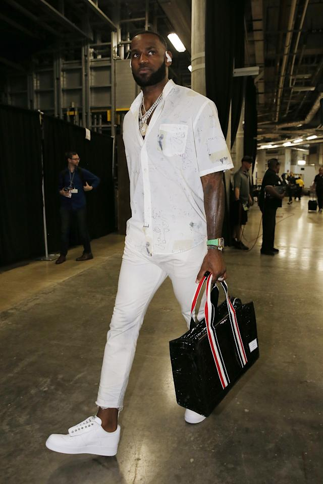 <p>WHAT: Our Legacy shirt, John Elliott jeans, New York Sunshine Nike sneakers, Thom Browne bag</p> <p>WHERE: The Los Angeles Lakers-Miami Heat game in Los Angeles</p> <p>WHEN: December 13, 2019</p> <p>WHY: This is how you do white-Christmas style when you're breezing into Miami for the weekend.</p>