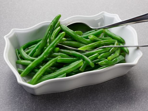 <p>Toss 1 pound of green beans, 2 tablespoons butter, ¼ cup water and a large pinch of salt in a large microwave-safe bowl. Cover and microwave for 4 minutes. Toss, then cook for 1-minute intervals, tossing after each, until the beans are bright green and crisp-tender.</p>