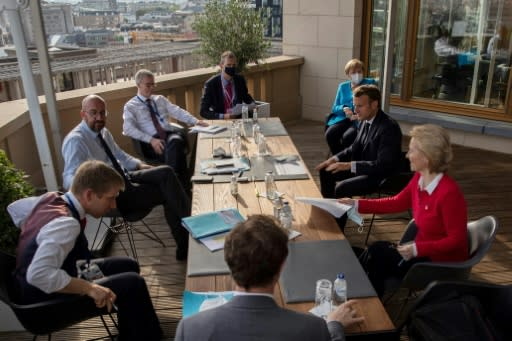 Meeting as 27 around a single table proved unwieldy, so European Council President Charles Michel (2nd L), often invited smaller groups of leaders onto his roof terrace to break down details of the huge post-virus rescue plan