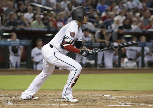 Arizona Diamondbacks' Ketel Marte watches his two-run triple during the first inning of the team's baseball game against the Pittsburgh Pirates, Tuesday, June 12, 2018, in Phoenix. (AP Photo/Rick Scuteri)
