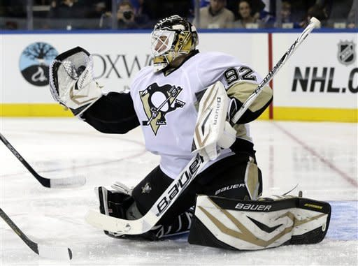 Pittsburgh Penguins goalie Tomas Vokoun makes a save during the second period of the NHL hockey game against the New York Rangers in New York, Sunday, Jan. 20, 2013.  (AP Photo/Seth Wenig)