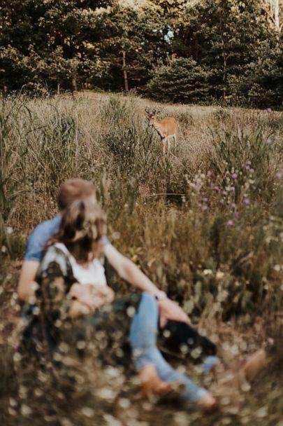 PHOTO: The couple noticed the deer wandering into their photo shoot. (Courtesy Eldina Kovacevic/Inna Kova Photography)