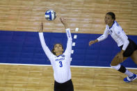 Kentucky'sMadison Lilley (3) sets the ball for Madi Skinner (2) during the first set against Washington in a semifinal in the NCAA women's volleyball championships Thursday, April 22, 2021, in Omaha, Neb. (AP Photo/John Peterson)