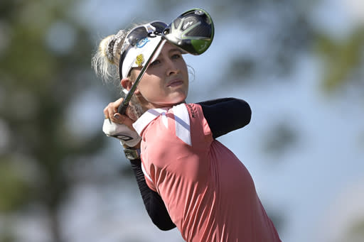 Nelly Korda watches her tee shot on the fourth hole during the final round of the Tournament of Champions LPGA golf tournament, Sunday, Jan. 24, 2021, in Lake Buena Vista, Fla. (AP Photo/Phelan M. Ebenhack)
