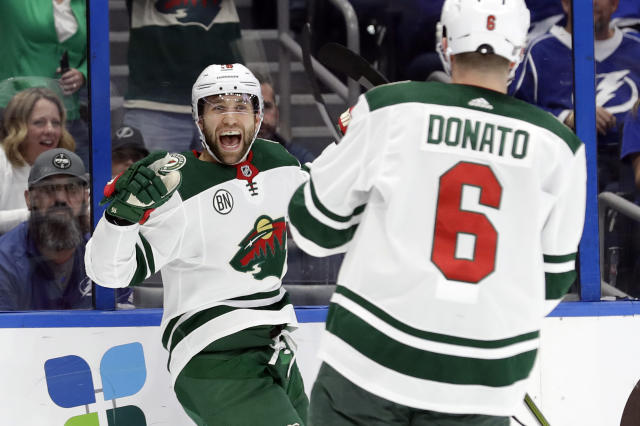Minnesota Wild left wing Jason Zucker (16) celebrates his goal against the Tampa Bay Lightning with center Ryan Donato (16) during the first period of an NHL hockey game Thursday, March 7, 2019, in Tampa, Fla. (AP Photo/Chris O'Meara)