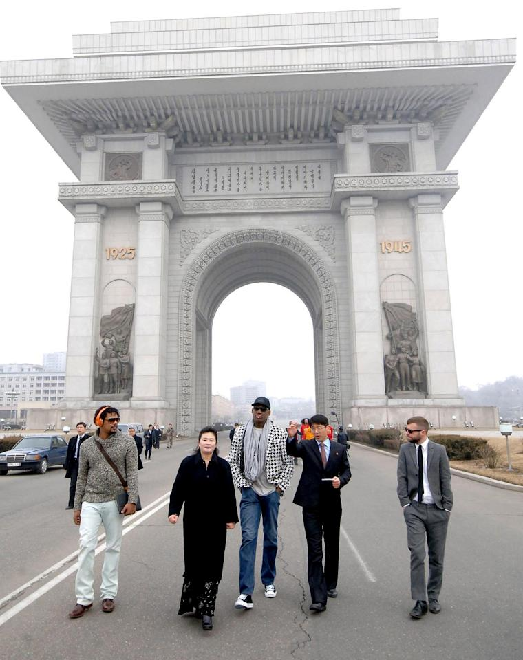 """In this image released by the Korean Central News Agency (KCNA) and distributed by the Korea News Service, former NBA star Dennis Rodman, third right, visits the Arch of Triumph in Pyongyang in North Korea Friday, March 1 2013. Ending his unexpected round of basketball diplomacy in North Korea on Friday, ex-NBA star Rodman called leader Kim Jong Un an """"awesome guy"""" and said his father and grandfather were """"great leaders."""" (AP Photo/KCNA via KNS) JAPAN OUT UNTIL 14 DAYS AFTER THE DAY OF TRANSMISSION"""