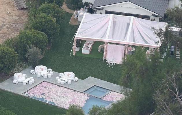This snap of Kylie Jenner's house from above appears to show a pink themed party being prepared, thought to be her own baby shower. Source: Backgrid