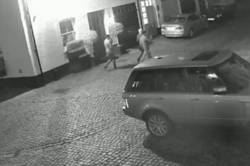 Three men can be seen walking towards the house on the evening of the burglary (Met police)