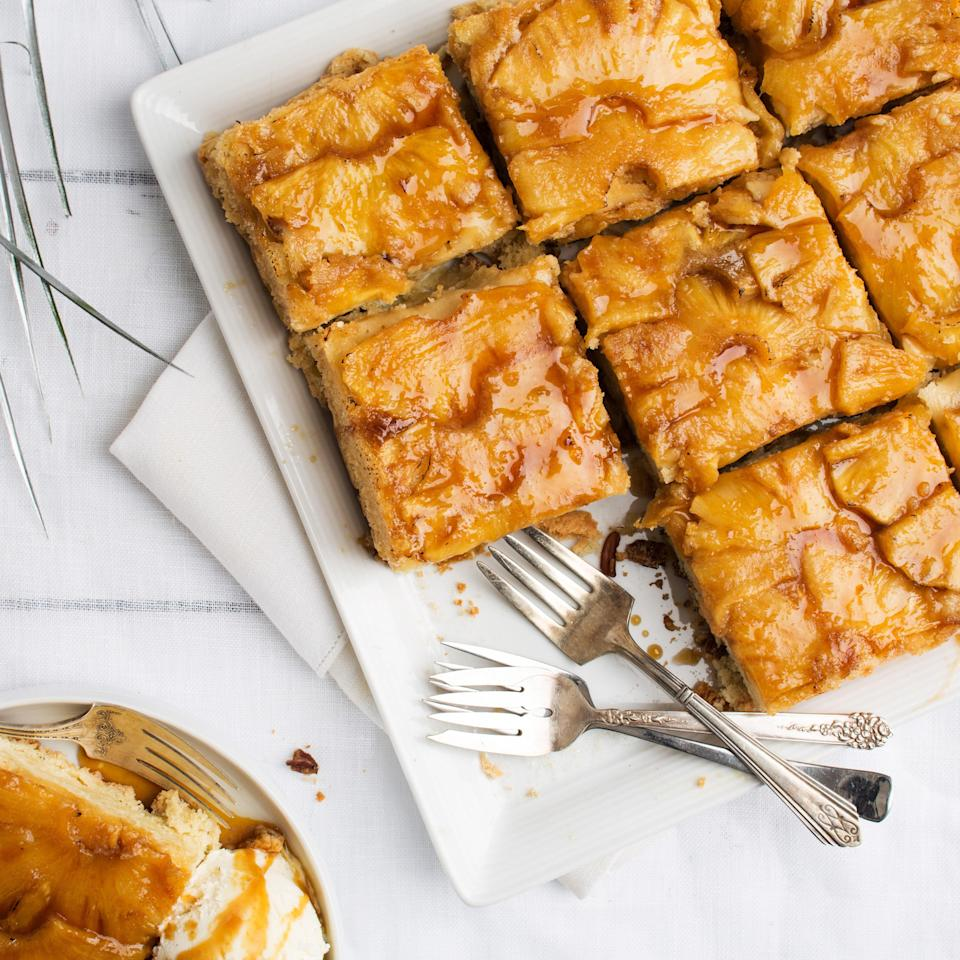 """Dark rum provides flavor for both the glaze and the cake itself in this caramel-rich Puerto Rican dessert with pineapples. <a href=""""https://www.epicurious.com/recipes/food/views/puerto-rican-pineapple-rum-cake-51126900?mbid=synd_yahoo_rss"""" rel=""""nofollow noopener"""" target=""""_blank"""" data-ylk=""""slk:See recipe."""" class=""""link rapid-noclick-resp"""">See recipe.</a>"""